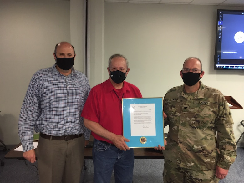 August 12, Chief of Construction, Chad N. McLeod and COL Christopher Crary recognize Tom McDonald as Far East District Hard Hat of the Year Award Winner.