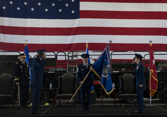 Gen. Jacqueline D. Van Ovost, commander of Air Mobility Command, right, salutes Gen. Charles Q. Brown, Jr., Chief of Staff of the Air Force, during the AMC change of command ceremony at Scott Air Force Base, Illinois, Aug. 20, 2020. The ceremony marked a historic Air Force first with back-to-back female generals commanding a major command.. (U.S. Air Force photo by Senior Airman Solomon Cook)