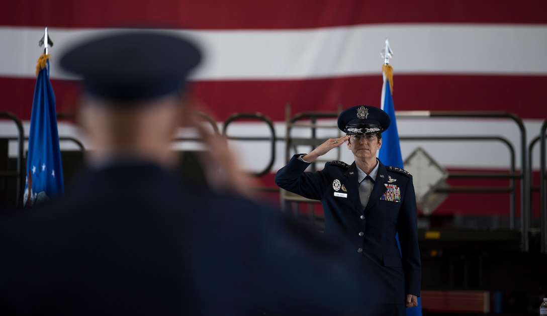 Gen. Jacqueline D. Van Ovost, commander of Air Mobility Command, returns her first salute to Lt. Gen. Brian Robinson, AMC deputy commander, during the AMC change of command ceremony at Scott Air Force Base, Illinois, Aug. 20, 2020. AMC provides rapid, global mobility and sustainment for America's armed forces. (U.S. Air Force photo by Senior Airman Solomon Cook)