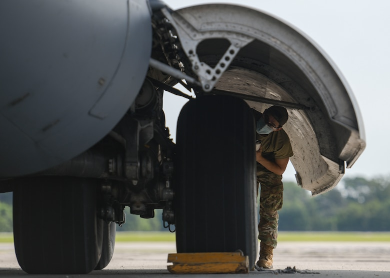 Airman 1st Class Brian Ireta, an aerospace mechanic assigned to the 437th Aircraft Maintenance Squadron, checks the tire pressure on a C-17 Globemaster III at Joint Base Charleston, S.C., Aug. 18, 2020. The 437th AMXS inspects, services, and maintains the assigned C-17 aircraft at Joint Base Charleston.