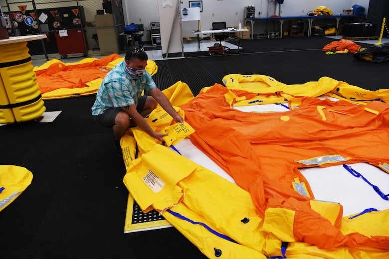 Technician with life raft