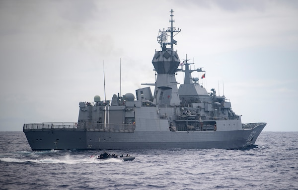U.S. Navy Sailors in a rigid hull inflatable boat, assigned to USS Chung-Hoon (DDG 93), circle the Royal Australian Navy frigate HMAS Stuart (FFH 153) during Exercise Rim of the Pacific (RIMPAC) 2020.