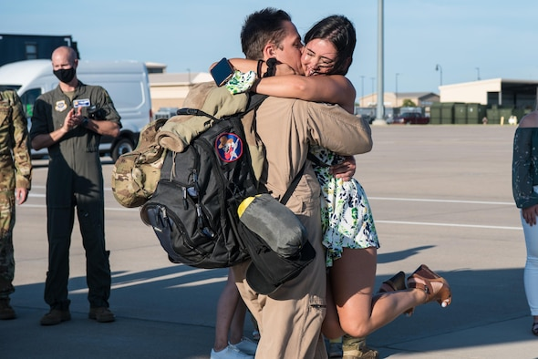 Capt. Collin Tuthill, 349th Air Refueling Squadron pilot, hugs his girlfriend, Erika Black, after returning home from a deployment to Southwest Asia, Aug. 20, 2020, at McConnell Air Force Base, Kansas. Tuthill and the rest of the team delivered more than 38 million pounds of fuel to 16 different airframes during the deployment. (U.S. Air Force photo by Senior Airman Alexi Bosarge)