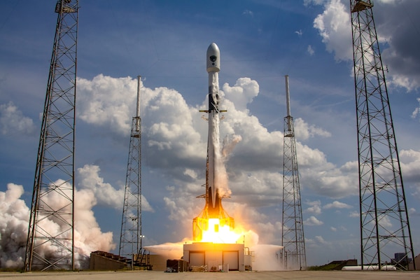 A rocket launches from a launch pad at Cape Canaveral Air Force Station.