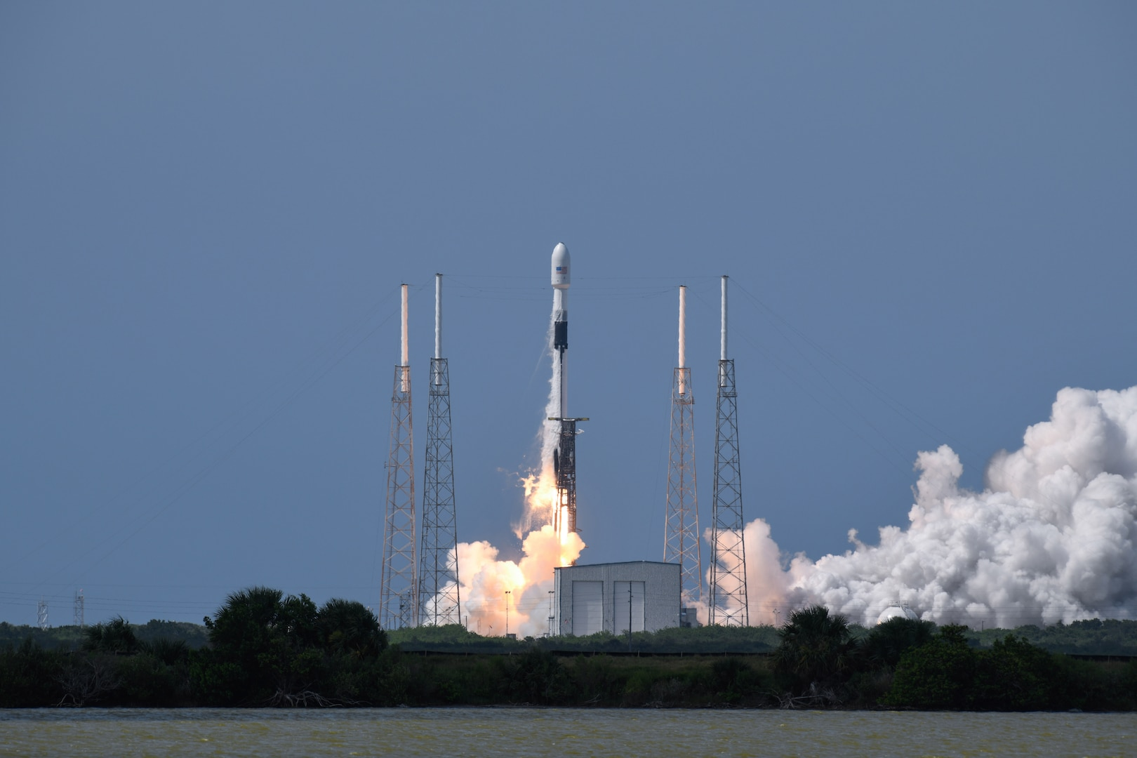 Photo of a rocket launching from a launch pad