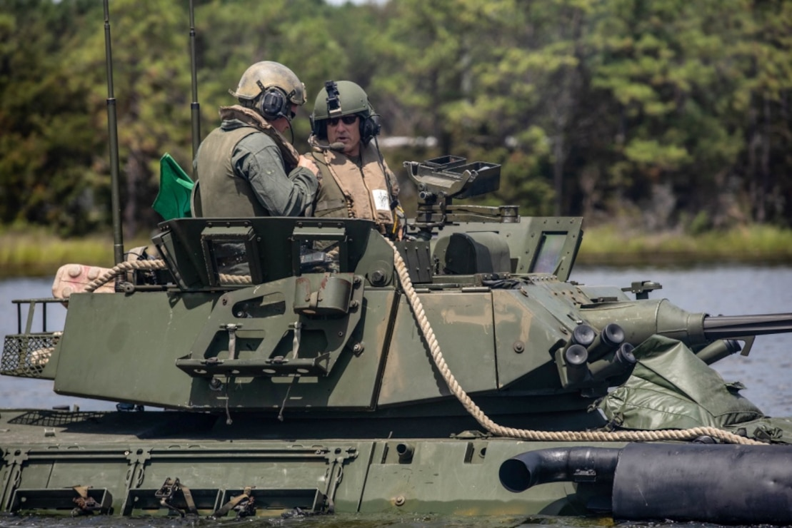 U.S. Marine Corps Maj. Gen. Francis L. Donovan, Commanding General of 2d Marine Division, rides on a Light Armored Vehicle-25 at Camp Lejeune, North Carolina, August 18, 2020. Donovan voiced his opinions on possible changes to doctrine concerning safety and training for 2d Light Armored Reconnaissance Battalion. (U.S. Marine Corps photo by Lance Cpl. Brian Bolin Jr.)