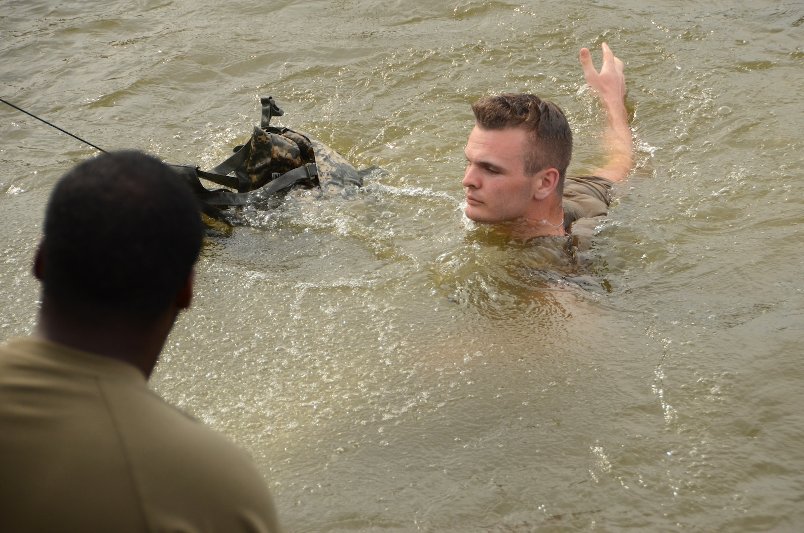 Spc. Braxton Todd, a Virginia National Guard Soldier assigned to the Fort Belvoir-based Headquarters Battalion, 29th Infantry Division, completes the water combat survival test during Day 3 of the Region II Best Warrior Competition, July 30, 2020, at Edgewood Area Aberdeen Proving Ground, Maryland. (U.S. National Guard photo by A.J. Coyne)