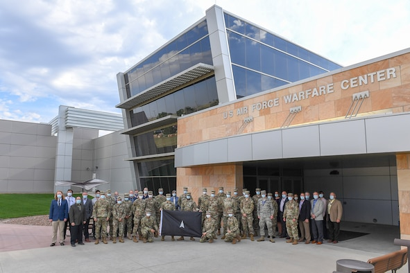 Space Flag 20-3 participants stand in front of the U.S. Air Force Warfare Center at Schriever Air Force Base, Colorado. This was the first Space Flag exercise completed as part of the new Space Training and Readiness