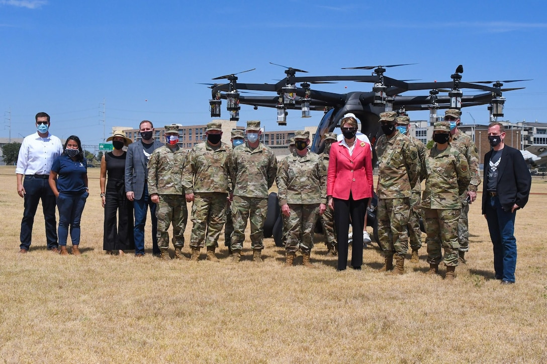 Secretary of the Air Force Barbara Barrett, Chief of Staff of the Air Force Gen. Charles Q. Brown, Jr., and Chief Master Sgt. of the Air Force JoAnne S. Bass, AFWERX Total Force teammates and Maj. Gen. Tracy R. Norris, Adjutant General of the Texas National Guard, pose in front of the Agility Prime partner, LIFT Aircraft, after an ORB flight demonstration during a visit at Camp Mabry, Texas, Aug. 20, 2020. Agility Prime is a non-traditional program seeking to accelerate the commercial market for advanced air mobility vehicles. (Air National Guard photo by Staff. Sgt. Sean Kornegay)