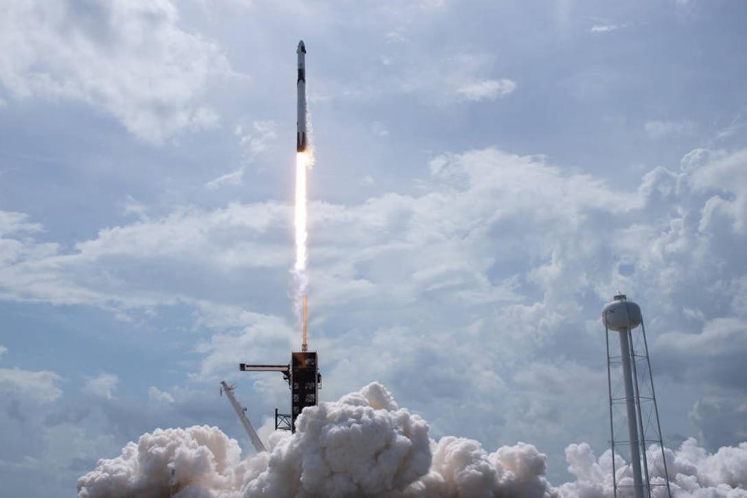 Rocket lifts off.