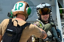 Sailor greets pilot on the flight line.