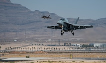 Aircraft lands on flight line.