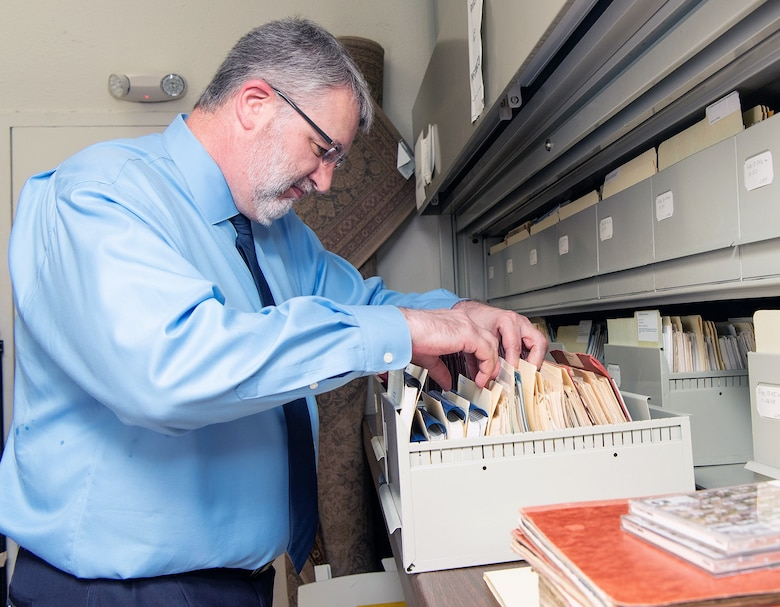 Lane Bourgeois, 12th Flying Training Wing historian, sifts through a pile of historical documents in his office at Joint Base San Antonio-Randolph June 12, 2019.