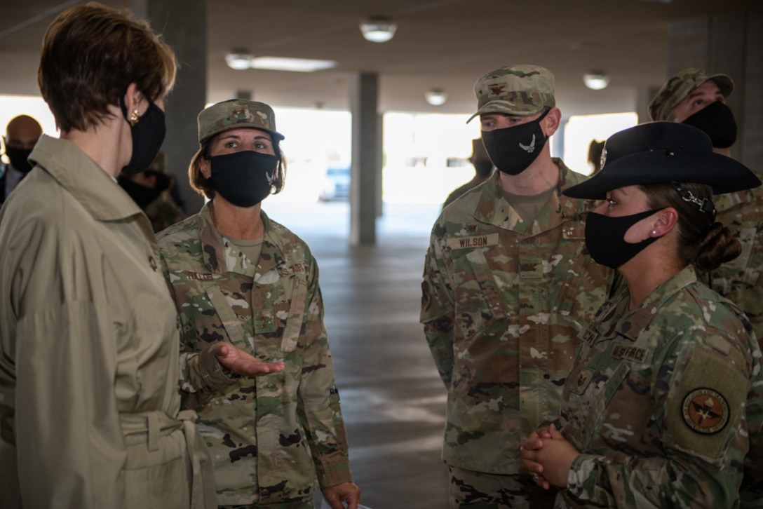 Secretary of the Air Force Barbara M. Barrett (left) listens as Maj. Gen. Andrea Tullos, 2nd Air Force commander, talks about basic military training during a tour of the Airman Training Complex Aug. 21, 2020, at Joint Base San Antonio-Lackland, Texas.