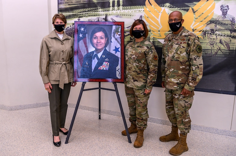 U.S. Secretary of the Air Force Barbara Barrett and Chief of Staff of the Air Force Gen. Charles Q. Brown, Jr. pose for a photo in front of Chief Master Sergeant of the Air Force JoAnne Bass's official portrait Aug. 21, 2020, at Joint Base San Antonio-Lackland, Texas.