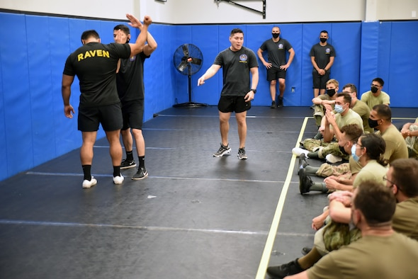 Phoenix Raven Qualification Instructors with the 421st Combat Training Squadron, demonstrate weapon defensive principles to the Phoenix Raven Qualification Course students in the U.S. Air Force Expeditionary Center's Redman Room, Aug. 14, 2020, at Joint Base McGuire-Dix-Lakehurst, New Jersey. The course, which ran from July 27 to Aug, 19, qualifies selected security forces personnel to perform as members of a force protection team assigned to deploy with Department of Defense aircraft to austere environments. Students are trained to perform as teams to detect, deter, and counter threats to personnel/aircraft at deployed locations by performing close-in aircraft security and advising aircrew on force protection measures. In addition, the course prepares students to conduct/report airfield assessments and perform flight deck denial duties on select missions. (U.S. Air Force photo by Maj. George Tobias)