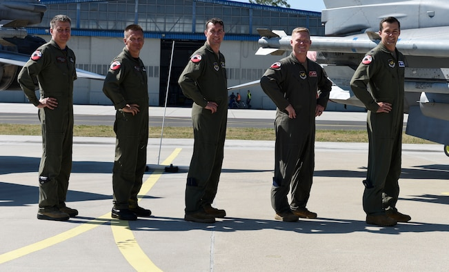 Starting far left, Polish Air Force Col. Tomasz Jatczak, 32nd Tactical Air Base commander, Brig. Gen. Iteneusz Nowak, 2nd Tactical Air Wing commander, U.S. Air Force Col. David Epperson, 52nd Fighter Wing commander, Lt. Col. Patrick Kennedy, 480th Expeditionary Fighter Squadron commander, and Lt. Col. Albert Roper, 52nd Operations Group Detachment One commander, stand in front of a static display for brief interviews at Łask AB, Poland, August 21, 2020. During Aviation Detachment Rotation 20.4, the Polish and U.S. forces will be flying, training and learning together as they work to foster regional security and prosperity. (U.S. Air Force photo by Senior Airman Melody W. Howley)