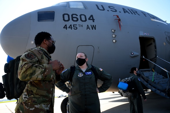 Reserve Citizen Airmen, Tech. Sgt. Ian Warrior and Master Sgt. Brandi Seibel, both 932nd Aeromedical Evacuation Squadron (AES) technicians, chat about the training plan before loading gear on a C-17 Globemaster, August 22, 2020, at Scott Air Force Base, Ill.  The training opportunity on the aircraft was provided by the 445th Airlift Wing, an Air Force Reserve unit visiting from Wright Patterson Air Force Base, Ohio. Training featured interaction between medical personnel and loadmasters, working together on care of equipment, reacting to potential scenarios and care of patients aboard the aircraft, simulating a deployed environment.  (U.S. Air Force photos by Lt. Col. Stan Paregien)
