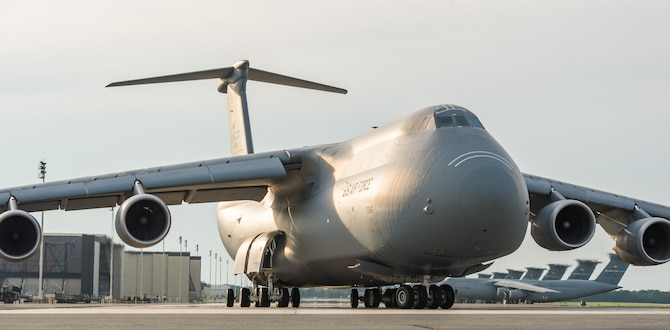A C-5M Super Galaxy taxis down the flight line prior to an early evening takeoff Aug. 21, 2020, at Dover Air Force Base, Delaware. Eighteen C-5M's are assigned to Dover AFB, along with 13 C-17 Globemaster IIIs that provide 20 percent of the nation's outsized airlift capacity. (U.S. Air Force photo by Roland Balik)