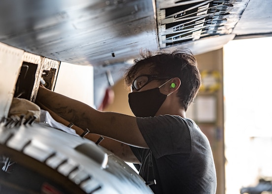 Republic of Singapore Air Force Military Expert One Staff Sgt. Concenciao Axel, 425th Fighter Squadron maintainer, performs maintenance on an F-16C Fighting Falcon Aug. 5, 2020, at Luke Air Force Base, Ariz.
