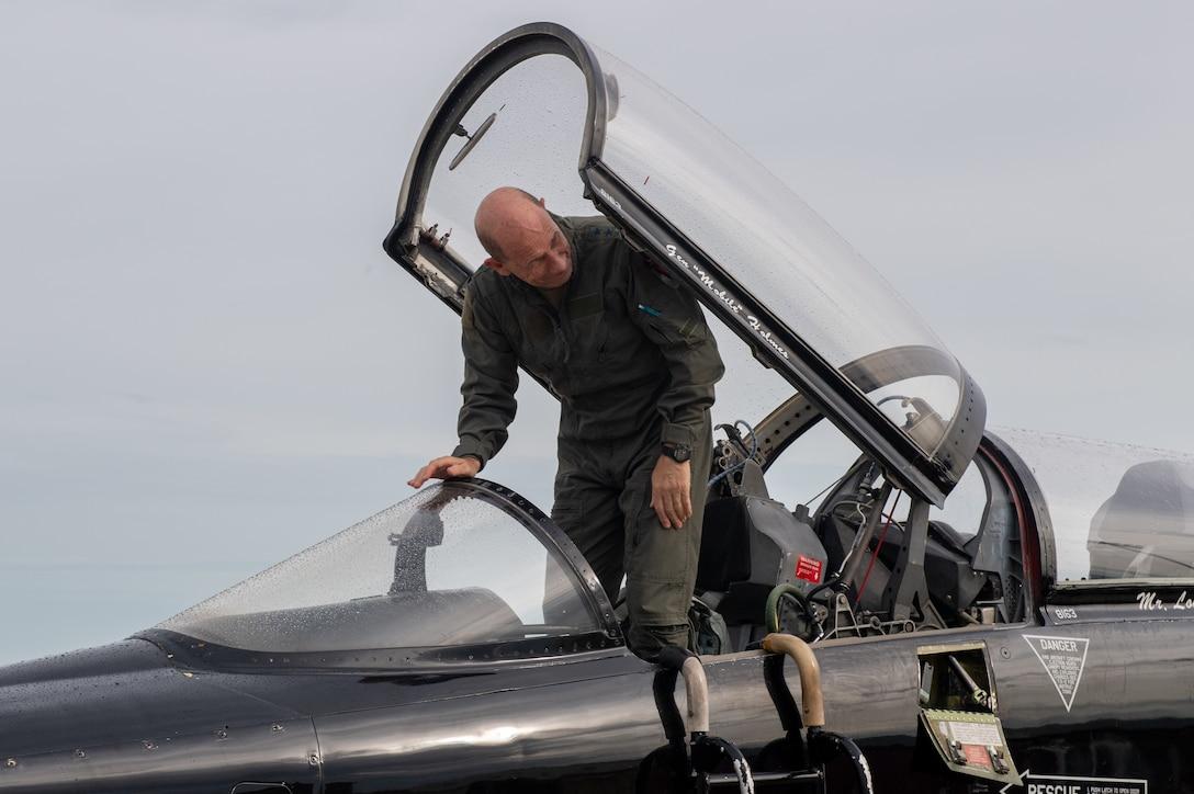 Gen. Holmes exiting aircraft
