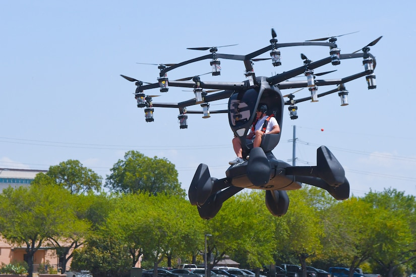 A person pilots an electric vertical takeoff and landing.