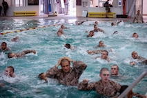Recruits with Lima Company, 3rd Recruit Training Battalion, participate in the Water Survival Basic Qualification course at Marine Corps Recruit Depot San Diego, Aug. 17, 2020.