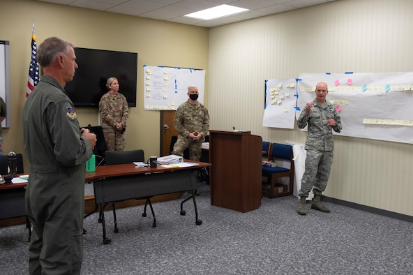 Master Sgt. Adam Evans, provides his part in a presentation during the continuous process improvement program to Col. Larry Shaw, 434th Air Refueling Wing commander, at Grissom Air Reserve Base, Indiana, July 30, 2020. The continuous process improvement team focused their efforts on improving the administrative discharge packages process. Their goal was to reach the Air Force standard on these packages while receiving 100 percent accuracy. (U.S. Air Force photo by Senior Airman Michael Hunsaker)