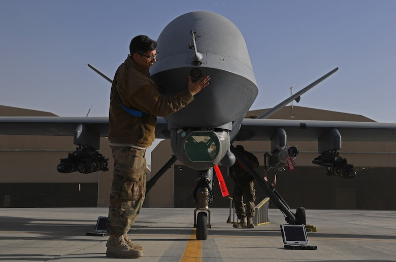 U.S. Air Force Airman 1st Class Eric Rosales, 62nd Attack Squadron crew chiefs, works on an MQ-9 Reaper on Kandahar Airfield, Afghanistan, Jan. 18, 2018.  (U.S. Air Force photo by Staff Sgt. Sean Martin)