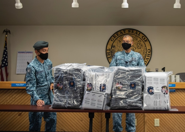 Royal Singaporean Air Force ME3 Robin Seo, 428th Fighter Squadron air force engineer, and RSAF ME4 Gene Tan, 428th FS command chief, prepare 2,000 face coverings for reception at the Mountain Home School District Office, Aug. 6, 2020, in Mountain Home, Idaho. The 428th FS also donated 180 face shields to help aid the MHSD's battle against COVID-19. (U.S. Air Force photo by Airman 1st Class Gary Hilton)