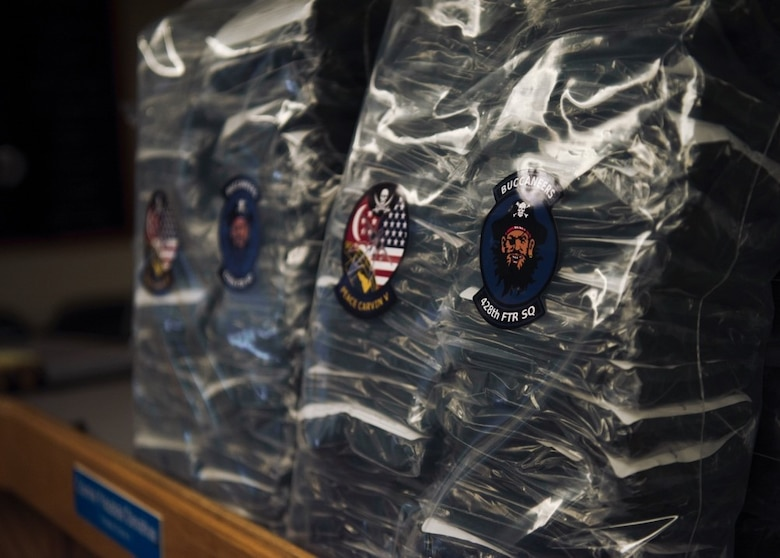 "2,000 face coverings sport the 428th Fighter Squadron's famous ""Buccaneers"" patch at the Mountain Home School District Office, Aug. 6, 2020, in Mountain Home, Idaho. The 428th FS distributed 2,000 face coverings and 180 face shields to aid the MHSD's battle against COVID-19. (U.S. Air Force photo by Airman 1st Class Gary Hilton)"