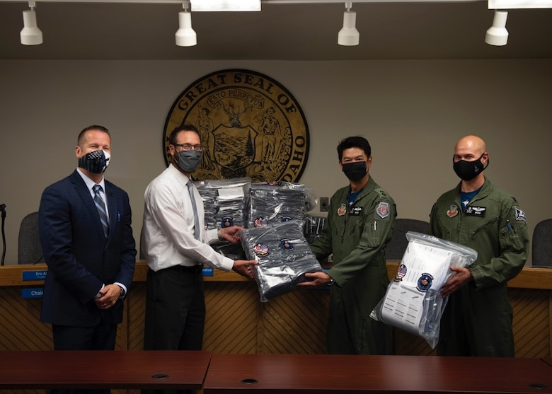 (From left to right) Rich Sykes, the mayor of Mountain Home, Mr. James Gilbert, Mountain Home School District Superintendent, Royal Singaporean Air Force Lt. Col. Shewan Goh, 428th Fighter Squadron senior ranking officer, and U.S. Air Force Lt. Col. Nicholas Jurewicz, 428th Fighter Squadron commander, pose with a package of donated face coverings at the Mountain Home School District Office, Aug. 6, 2020, in Mountain Home, Idaho. The 428th FS distributed 2,000 face coverings and 180 face shields to aid the MHSD's battle against COVID-19. (U.S. Air Force photo by Airman 1st Class Gary Hilton)