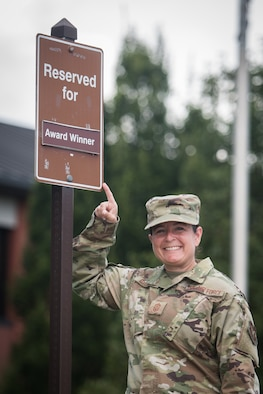 """Chief Master Sgt. Barbara Gilmore, command chief, 932nd Airlift Wing, showcases the new allocated parking spot located in the front of the 932nd AW Headquarters building, Aug. 18, 2020, Scott Air Force Base, Illinois.  932nd AW Annual and Quarterly award winners now can compete in a first-come competition for front row prime parking spot during weekdays and unit training assembly (UTA) weekends. """"With parking sometimes limited during a UTA weekend, I wanted to find a way to honor our award winners for prime parking, said Gilmore about the importance of creating the parking spot for award winners. (U.S. Air Force photo by Christopher Parr)"""