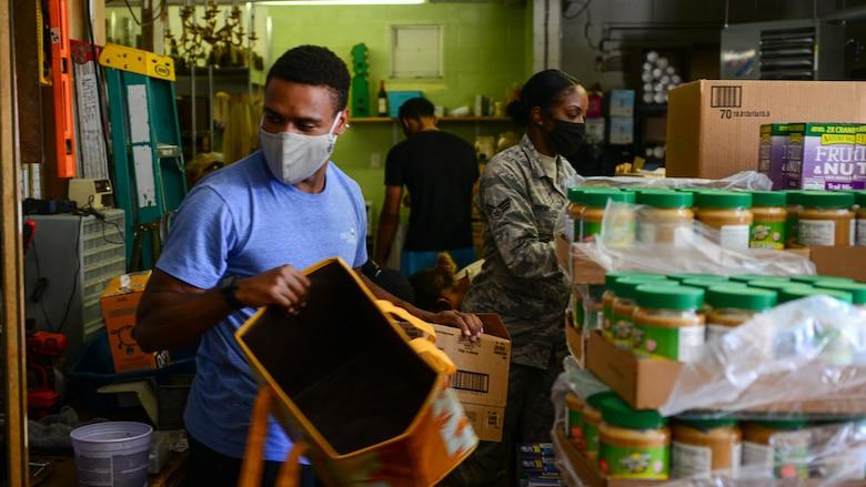 SrA Monzell Wiggins sorts through donations