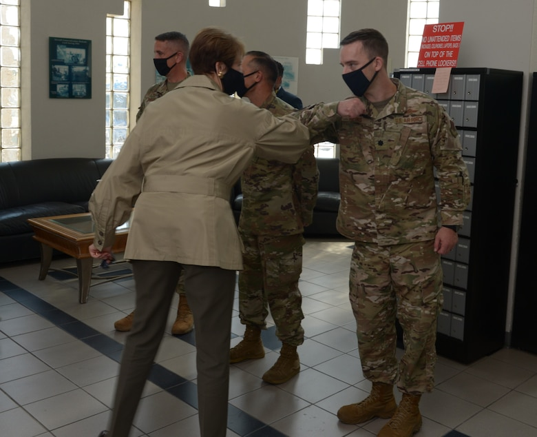 Lt. Col. John Heins, 91st Cyberspace Operations Squadron commander bumps elbows in greeting with SecAF Barbara M. Barrett