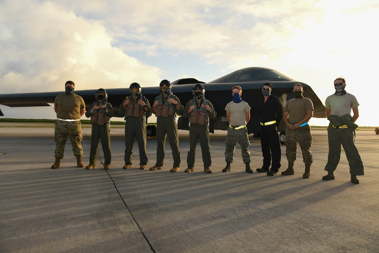 U.S. Air Force B-2 Spirit Stealth Bomber pilots and maintainers assigned to the 393rd Expeditionary Bomb Squadron, deployed from Whiteman Air Force Base, Missouri, pose for a photo after a flying mission at Naval Support Facility Diego Garcia, to support a Bomber Task Force mission,  Aug. 17, 2020. U.S. Strategic Command units regularly conduct training with U.S. Indo-Pacific Command to ensure a free and open Indo-Pacific. USSTRATCOM Bomber Task Force missions help maintain global stability and security while enabling units to become familiar with operations in different regions.(U.S. Air Force photo by Tech. Sgt. Heather Salazar)
