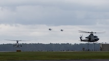 A UH-1Y Huey, AH-1Z Viper, and CH-53E Super Stallions with Marine Light Attack Helicopter Squadron 167 and Marine Heavy Helicopter Squadron 464 prepare to land during Exercise Deep Water 2020 at Marine Corps Air Station New River, North Carolina, July 29, 2020. The purpose of the exercise is to increase 2nd Marine Aircraft Wing's interoperability and readiness on a scale that simulates peer-level threats. (U.S. Marine Corps photo by Lance Cpl. Elias E. Pimentel III)