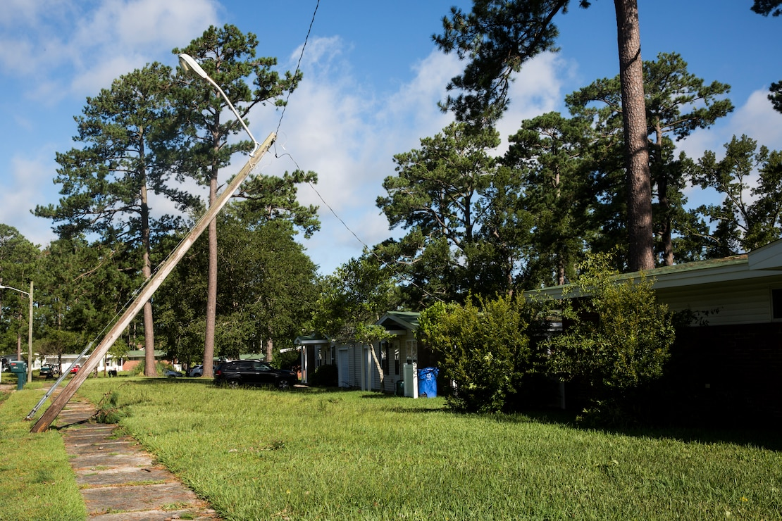 A power line lies partially fallen from Hurricane Isaias at base housing on Marine Corps Air Station New River, North Carolina, Aug. 4, 2020. U.S. Marines carried out recovery efforts in order to resume normal operations while following COVID-19 mitigation guidelines. (U.S. Marine Corps Photo by Lance Cpl. Christian Ayers)