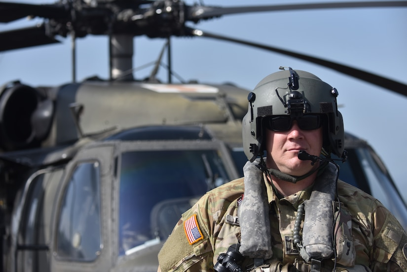 U.S. Army Chief Warrant Officer 2 Kristopher Pinson, a pilot assigned to the 1st Battalion 228th Aviation Regiment Air Ambulance Detachment at Joint Task Force-Bravo, stands in front of a UH-60 Blackhawk at Soto Cano Air Base, Honduras July 31, 2020. Pinson served as a co-pilot in the second aeromedical evacuation mission.