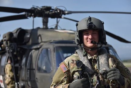 U.S. Army Lt. Ian Gidcomb, a pilot assigned to the 1st Battalion 228th Aviation Regiment Air Ambulance Detachment at Joint Task Force-Bravo, stands in front of a UH-60 Blackhawk at Soto Cano Air Base, Honduras July 31, 2020. Gidcomb served as a co-pilot in the third aeromedical evacuation mission.