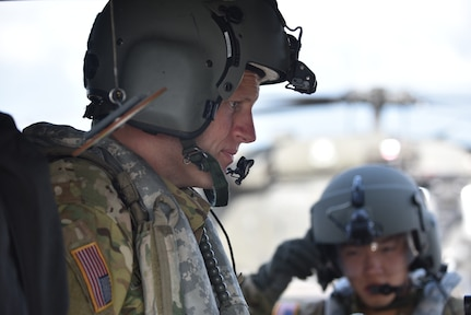 U.S. Army Capt. Richard Jackson (left), a flight doctor assigned to the 1st Battalion 228th Aviation Regiment Air Ambulance Detachment at Joint Task Force-Bravo, prepares to brief his team at Soto Cano Air Base, Honduras July 31, 2020. The Charlie Company of the 1-228th have been vital in providing emergency medical transportation throughout Honduras.