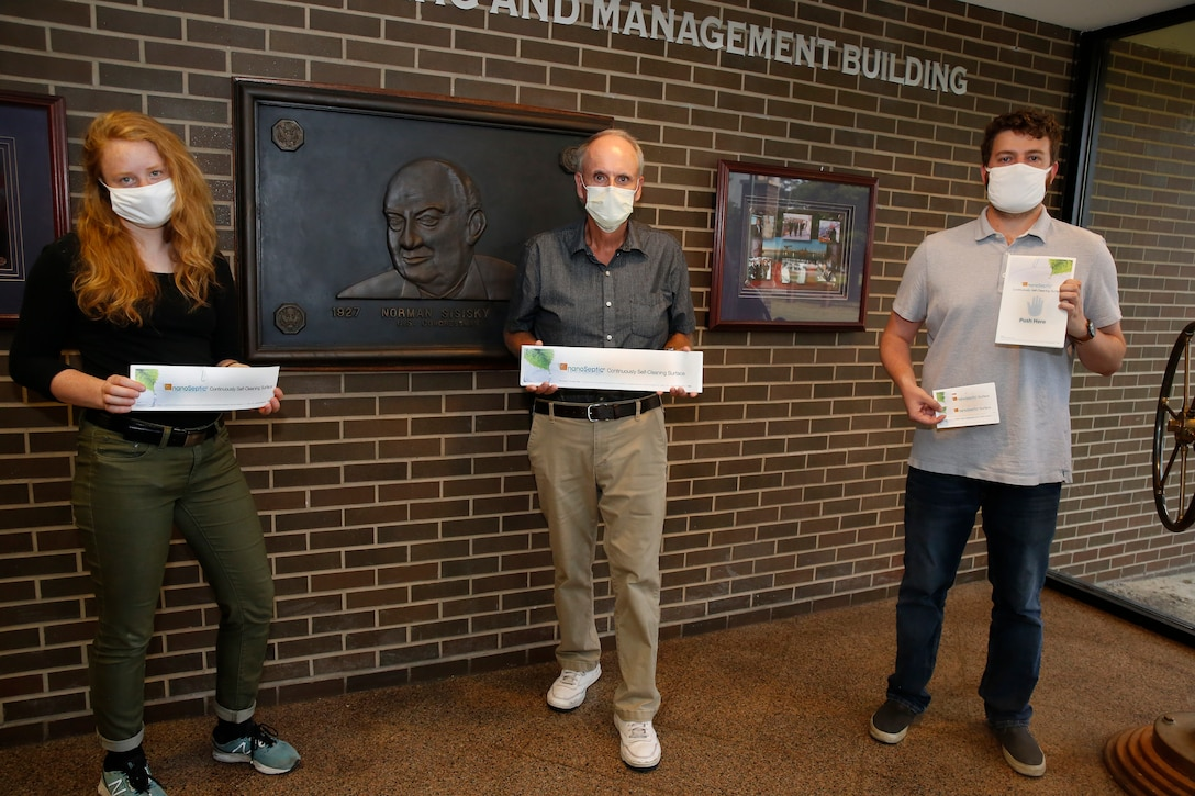 Engineers pose with NanoSeptic sheets.