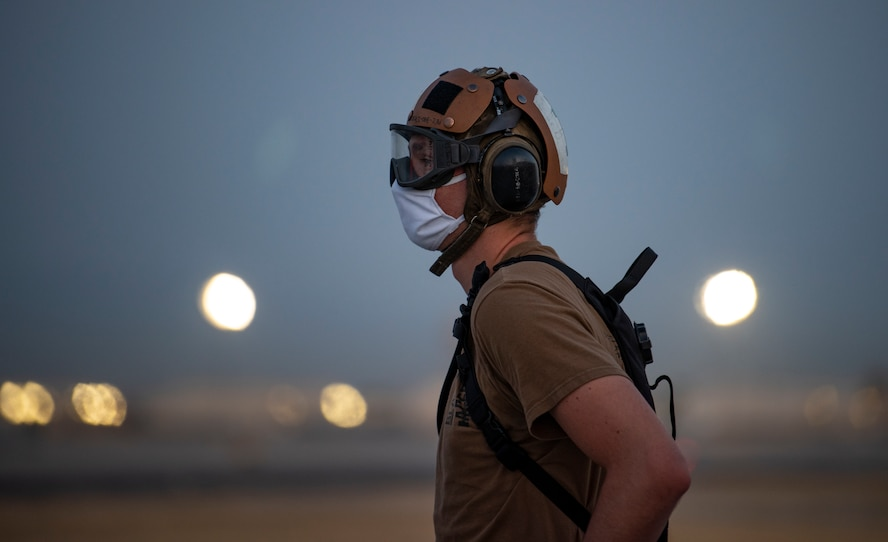 Sailor stands on the flight line.