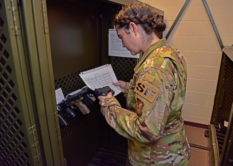 U.S. Air Force Airman 1st Class Sadie Rojas, a 354th Security Forces Squadron armorer, verifies a serial number on a personally-owned firearm on Eielson Air Force Base, Alaska, Aug. 21, 2020. All Eielson residents must register their firearms with the 354th SFS for accountability purposes. This photo has been altered for operational security purposes. (U.S. Air Force photo by Senior Airman Beaux Hebert)