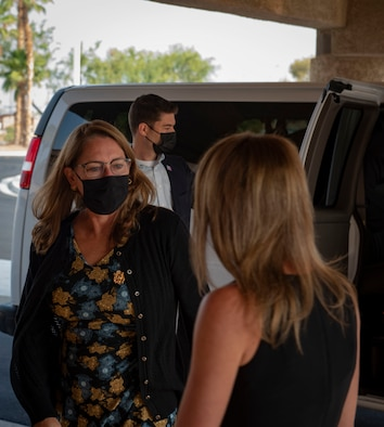 Wife of Secretary of Defense arrives at Nellis.