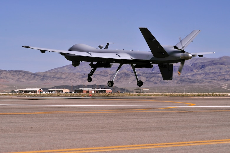 An MQ-9 Reaper remotely piloted aircraft takes off on a training mission, May 13, 2013. The Reaper is part of a remotely piloted aircraft system. A fully operational system consists of several sensor/weapon-equipped aircraft, ground control station, Predator Primary Satellite Link, and spare equipment along with operations and maintenance crews for deployed 24-hour missions. (U.S. Air Force photo by 432nd Wing/432nd Air Expeditionary Wing/Released)