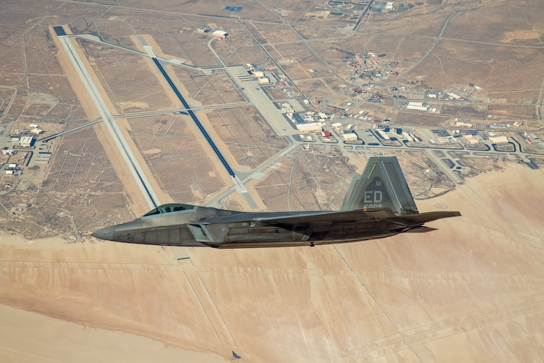 An F-22 Raptor assigned to the 411th Flight Test Squadron flies over Edwards Air Force Base, California, in 2018. The 411th FLTS successfully integrated the Common Range Integrated Instrumentation System (CRIIS) during a test flight Aug. 5 (Photo courtesy of Christopher Higgins, Lockheed Martin)