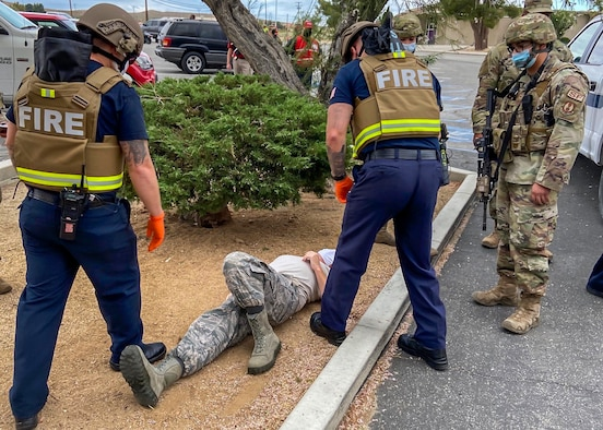 Members of the Edwards AFB Fire & Emergency Services and 412th Security Forces Squadron react during an active-shooter exercise at Edwards Air Force Base, California, Aug. 12 and 13. The two services employed the Rescue Task Force concept which aims to bring a quicker response time for victims.  (Air Force photo by Tech. Sgt. Felix Colon)