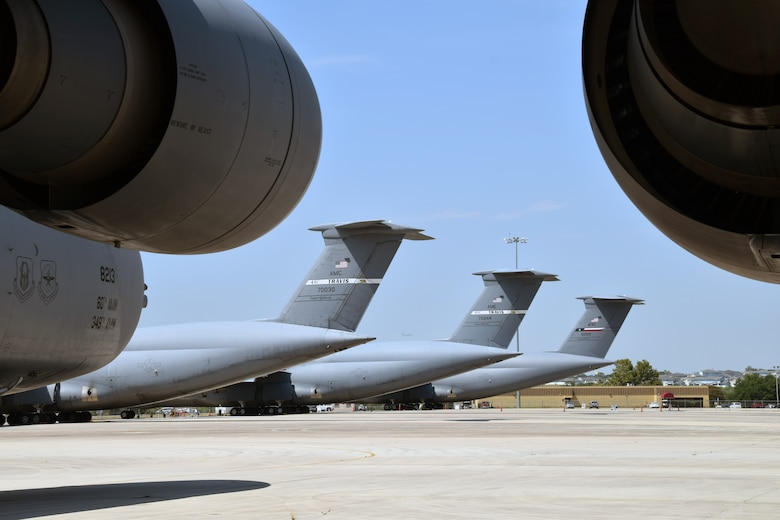 C-5M Super Galaxy cargo aircraft assigned to Travis Air Force Base, California, sit among C-5Ms with the 433rd Airlift Wing on a ramp Aug. 20 at Joint Base San Antonio-Lackland, Texas.