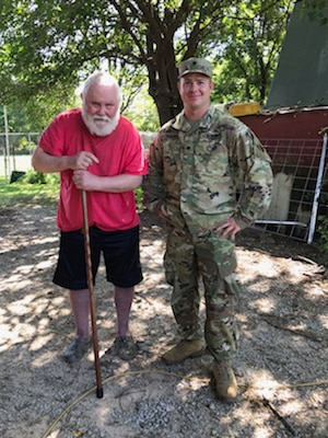Spc. Clinton Fauss, right, a truck driver with 120th Forward Support Battalion, 120th Engineer Battalion, 90th Troop Command, Oklahoma Army National Guard, helped rescue Lee Harkin after his vehicle rolled into a ditch outside Tulsa, Oklahoma, Aug. 12, 2020.